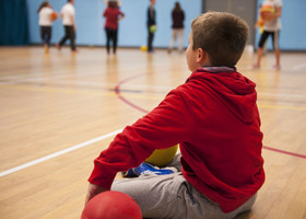 Child relaxing with a dodgeball