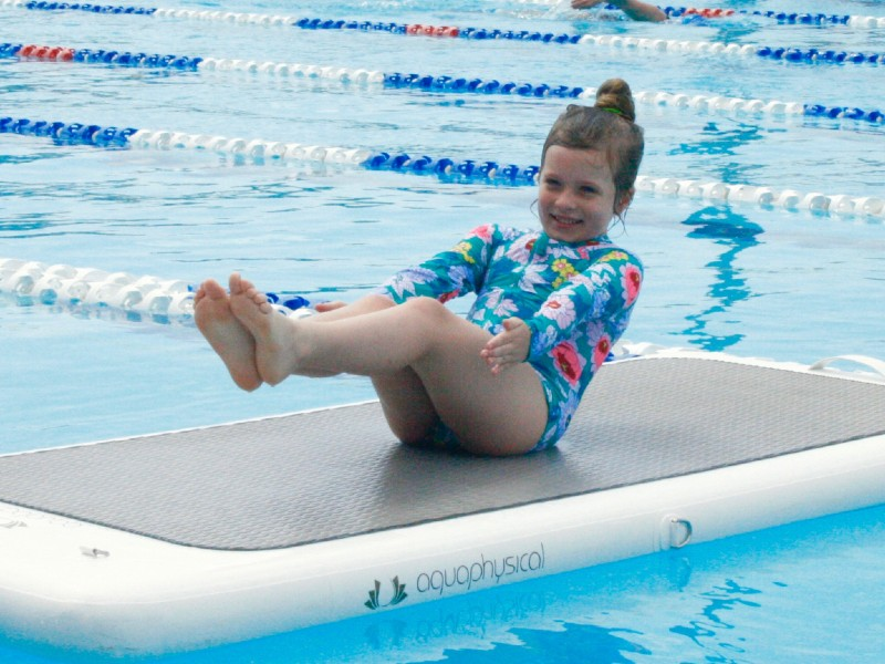 girl on a float fit board